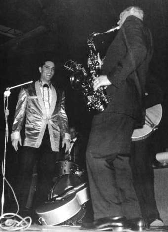 "Elvis and Boots Randolph performing ""Reconsider Baby"" at Pearle Harbor, Hawaii, March 25, 1961"