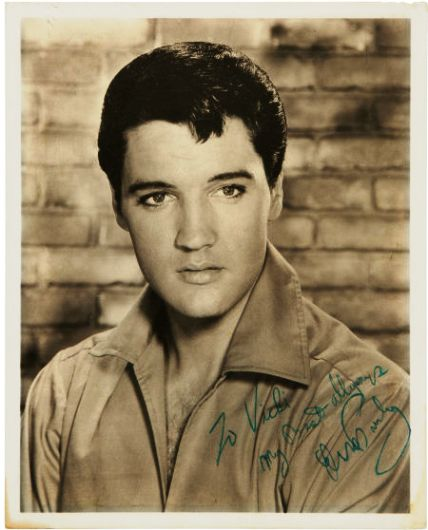 An Elvis Presley Signed Black and White Photograph, 1965