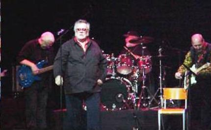 John Wilkinson on Stage with TCB Band