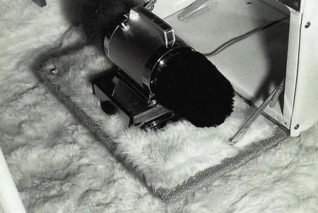 Close-up of shoe buffer and white mouton fur