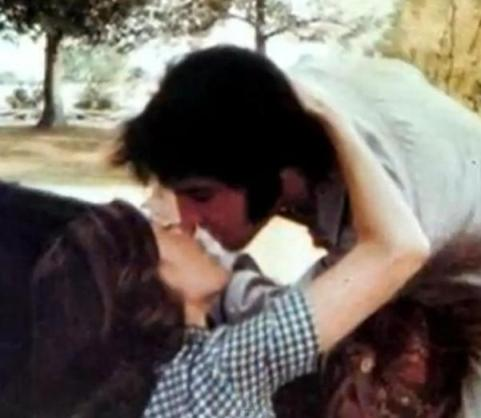 Elvis on horseback kissing Priscilla