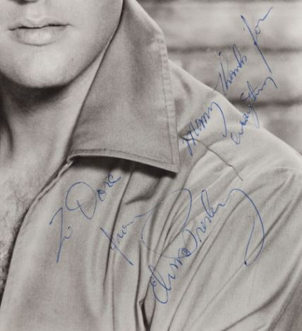Blow UP of Elvis Autograph onBlack and White Photograph