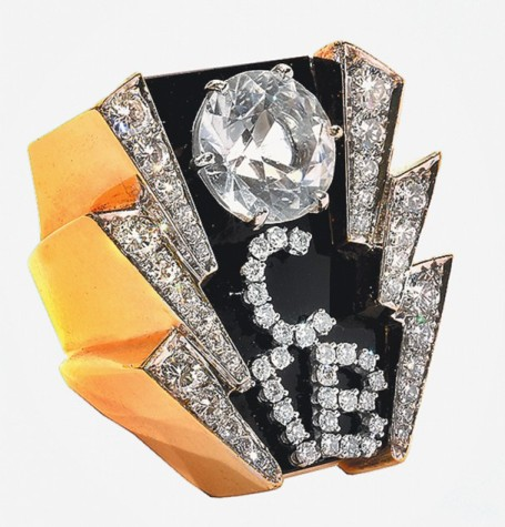 TCB Ring  An 11.5-carat diamond solitaire  two lightning bolts make up the edges. cost $35,000 in 1974