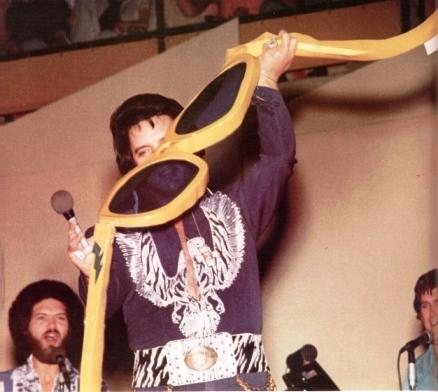 Elvis Holding Giant Sunglasses