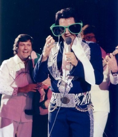 Elvis Wearing Big Blue Sunglasses