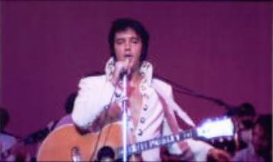 Elvis on Stage Wearing Guitar Strap