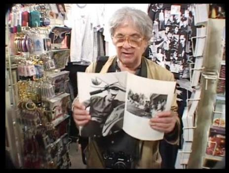 Al Wertheimer Showing his Photo in Magazine