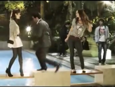 Elvis Jumping Between Dancing Girls in Ad