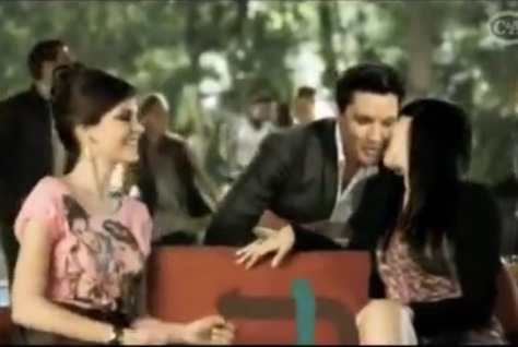 Elvis Kissing Girls on Couch in Ad