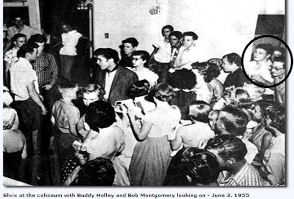 Buddy Holly and Bob Montgomery Looking at Elvis