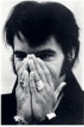 Elvis' Face Covered by Hands