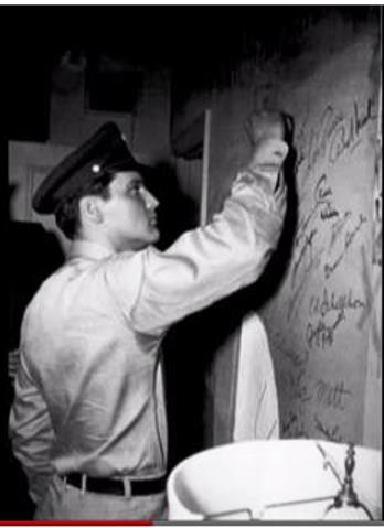 Elvis Writing Graffiti on Bathroom Wall