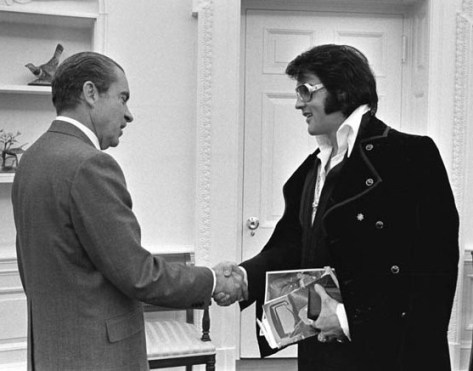 Elvis Presley shakes hands with President Nixon