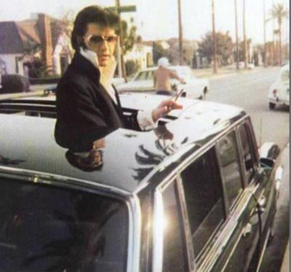 Cool Elvis Out the Sun Roof