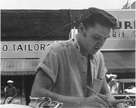 Elvis Signing Autographs Wearing Short Sleeve