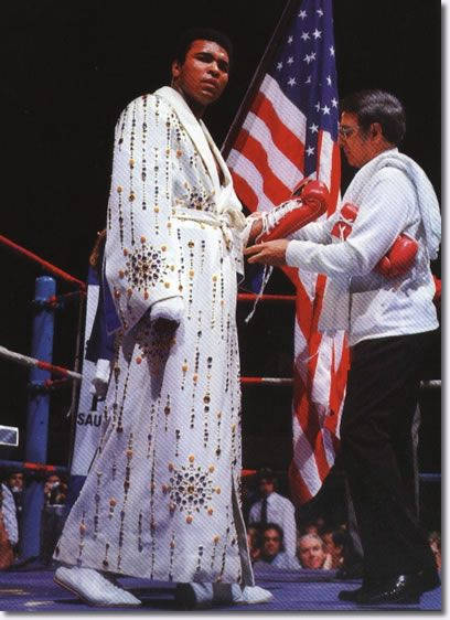 Ali wearing the robe that Elvis gave him. March 31 1974