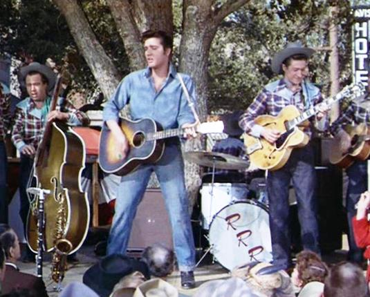Bill Black and Scotty Moore flank Elvis During Got A Lot of Livi to Do