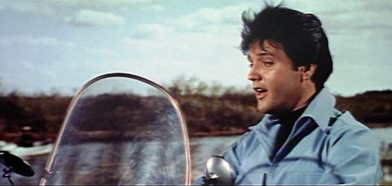 Elvis Singing on a Motorcycle in Clambake