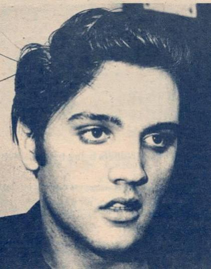 Young Elvis wearing eyeliner.