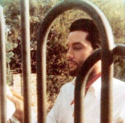 Elvis with Beard Looking Through Gates at Hillcrest Dr