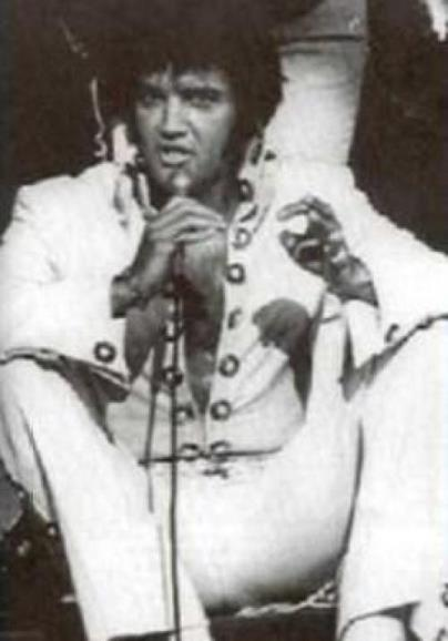 Elvis Sitting on Stage