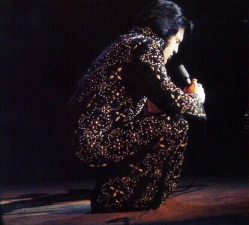 Elvis Squatting on Stage
