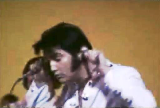 Elvis with Mics in His Ears