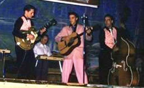 Elvis WearingPink Stage Pants With Black Saddle Stitching