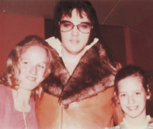 Elvis wearingCustom Made Tan Suede Trench Coat With Faux Fur Collar
