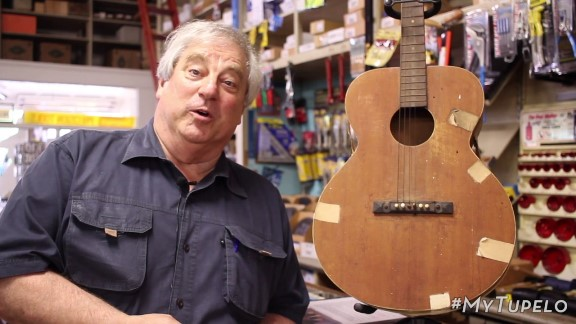 Larry Moss at Tupelo Hardware with Elvis Presley's First Guitar.