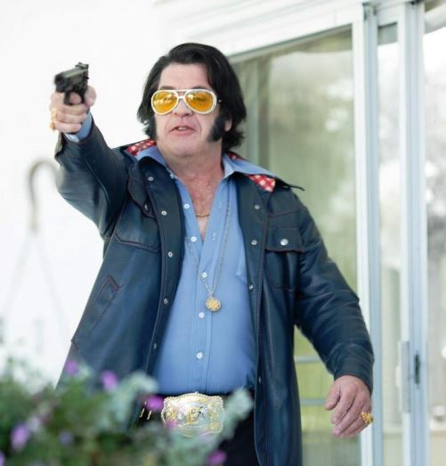 Actor in Elvis Lives Holding Gun