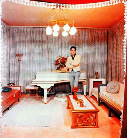 Elvis Standing in front of Knabe Piano