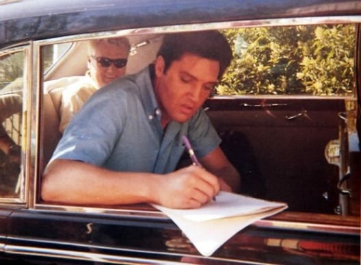 Elvis Signing Something