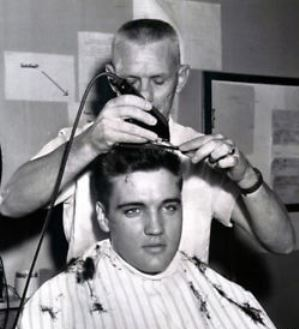 Elvis Getting His Army haircut.