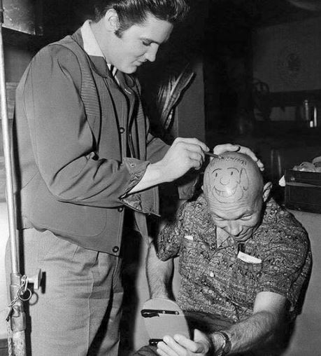 Elvis Drawing on Bald Head