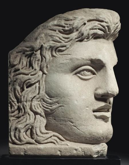 A ROMAN MARBLE ACROTERION CIRCA MID TO LATE 2ND CENTURY A.D.