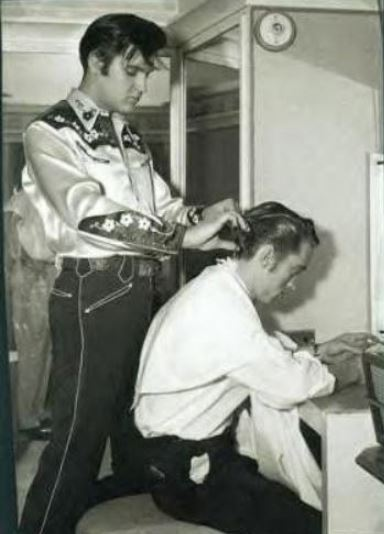 Elvis Presley cutting Billy Smith;s Hair 1957