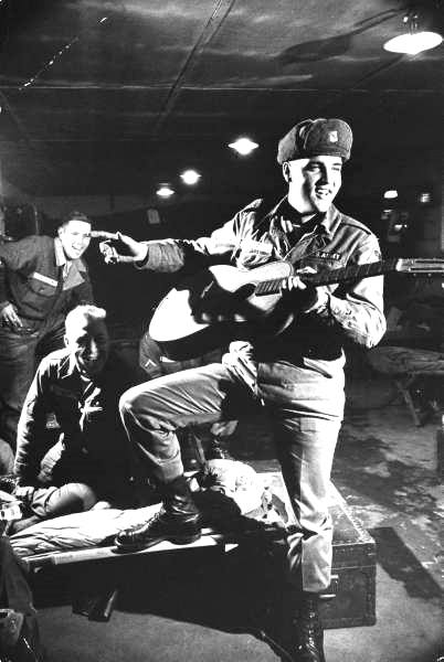 Elvis in Battle Fatigues Playing Guitar