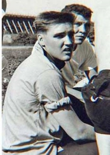 Elvis with Sleeves Rolled up
