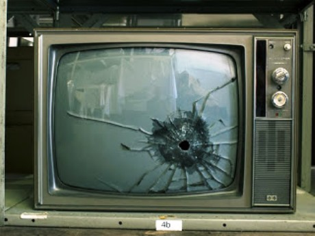 Photo of shot-up Elvis TV