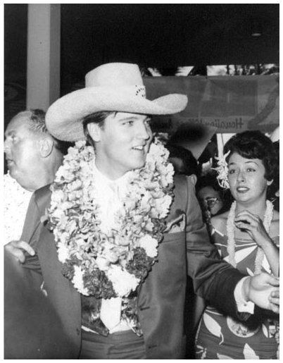 Elvis Wearing Cowboy Hat and Lei