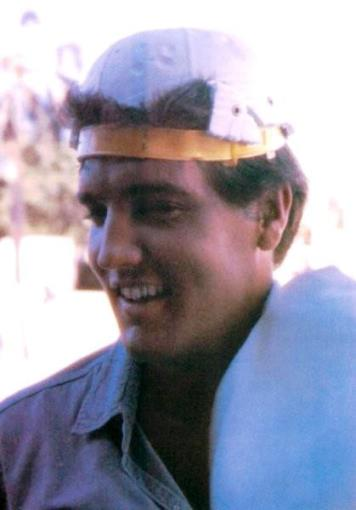 Elvis, Wearing Inside-out and Backwards Baseball Cap.