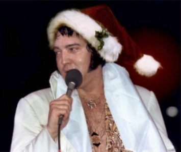 Elvis Wearing Santa Hat on Stage