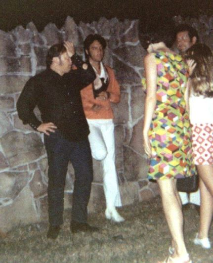 Elvis chatting with fans at the Graceland gates.