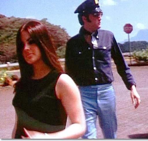 Priscilla and Elvis wearing a Police cap
