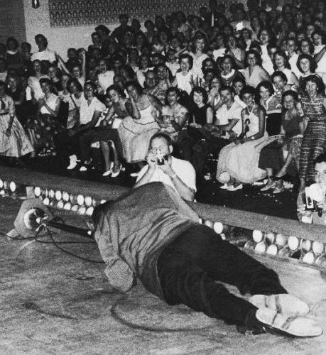 Elvis Gtrating on Stage Floor, New Orleans 1956