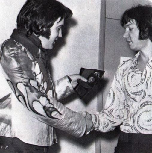 Elvis backstage with Eric Clapton before his opening night performance in Las Vegas. January 26th 1974