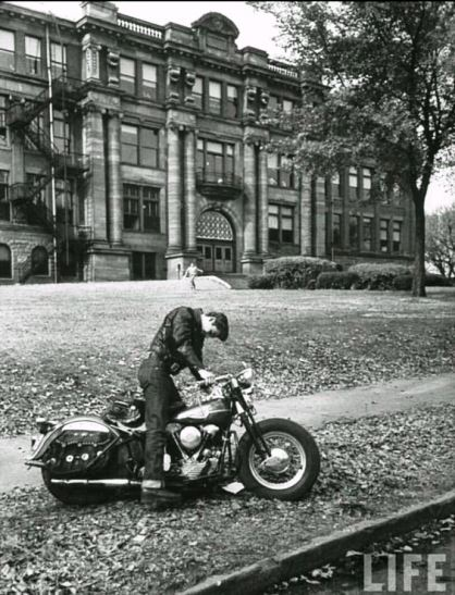 Elvis in front of Humes High school. Life magazine.