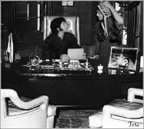 Elvis amd Priscilla behind desk