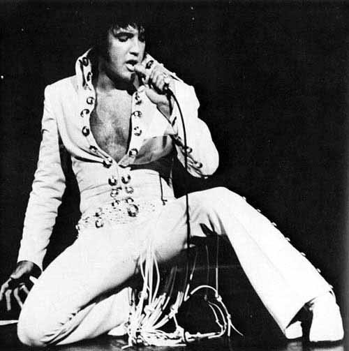 Elvis Sitting on Foot, other Leg Outstretched